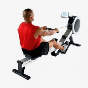 Lifecore Fitness R100 Rowing Machine With Man Wearing Workout Gear